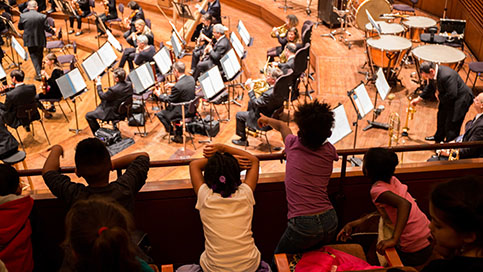 Children in Davies Symphony Hall watch a concert.