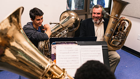 Students work with a tuba instructor