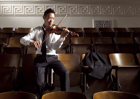 Portrait of Matthew Kan with a violin