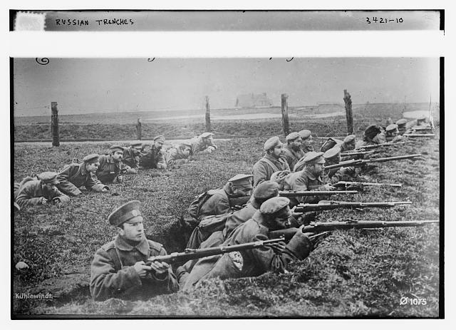 Russian soldiers with guns in trenches during World War I