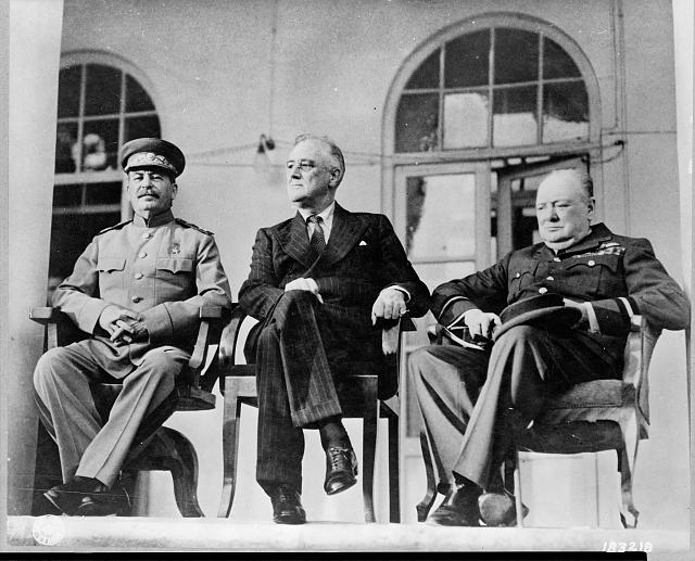 Roosevelt, Stalin, and Churchill on portico of Russian Embassy