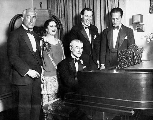 Ravel at the piano at his birthday party in New York City